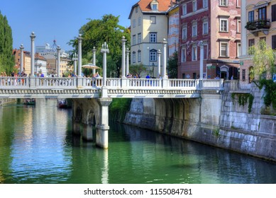 LJUBLJANA, SLOVENIA - AUGUST 10, 2018: The Cobblers' Bridge or the Shoemakers' Bridge is an arched pedestrian bridge crossing the river Ljubljanica in Ljubljana, the capital of Slovenia.