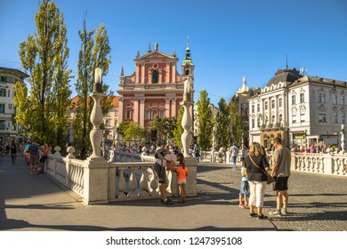LJUBLJANA, SLOVENIA, AUGUST 11 2017: Tromostovje square afternoon view with tourist activity, Ljubljana, capital of Slovenia