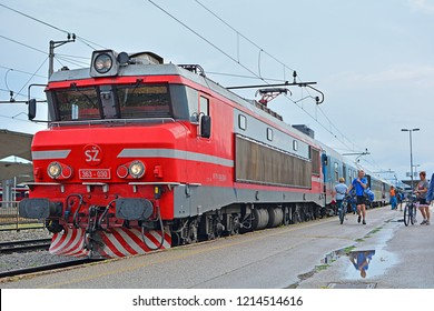 LJUBLJANA, SLOVENIA - AUGUST 14, 2018 - A characteristic SZ 363 electric locomotive of Slovenian Railways (SZ), hauling a passenger train, at Ljubljana railway station
