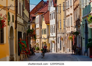 Ljubljana, Slovenia - August 19 2018:View of the city of Ljubljana in Summer with streets surrounded by colorful buildings in Baroque style