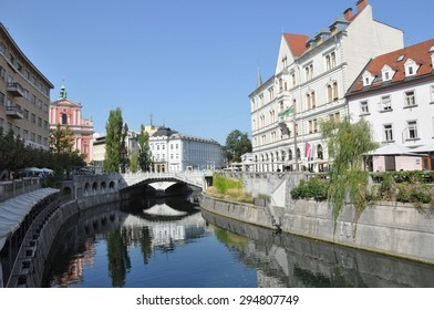 LJUBLJANA, SLOVENIA - August 22: Ljubljana city center and river Ljubljanica by day, Triple Bridge and The Franciscan Church of the Annunciation in the background on August 22,2012 in Ljubljana.