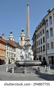 LJUBLJANA, SLOVENIA - August 22:Fountain of the Three Rivers of Carniola, by Francesco Robba in Town Square on August 22, 2012 in Ljublana. The St. Nicholas Cathedral can be seen in the background.