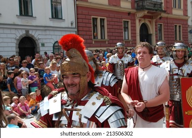 LJUBLJANA, SLOVENIA - AUGUST 24, 2014: Roman soldier bought a slave on a slave market in ancient Roman city; by members of Slovene Historical Society Poetovio at celebration of 2000 years of Emona.