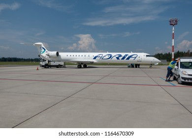 Ljubljana, Slovenia - August 25 2018: Adria Airways Bombardier CRJ-900 passenger jet parked at Ljubljana Airport. Adria is local carrier connecting short flights to the Balkans.