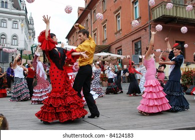 LJUBLJANA, SLOVENIA - AUGUST 28: Society Luna gitana prepared presentation of their society on Dvorni square in Ljubljana, Slovenia, on August 28, 2011, with flamenco dancing and music and treating.