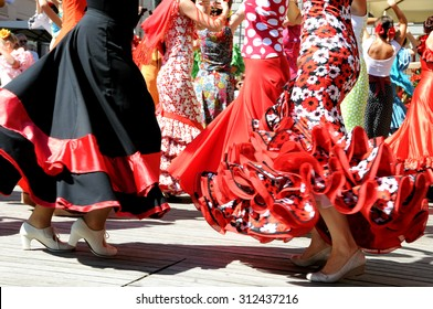 LJUBLJANA, SLOVENIA - AUGUST 29, 2015: Society Luna Gitana prepared traditional annual presentation of their society on Dvorni square with colorful flamenco dancing, music and banquet. Red dresses.