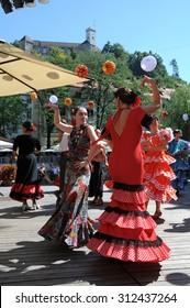 LJUBLJANA, SLOVENIA - AUGUST 29, 2015: Society Luna Gitana prepared annual presentation of their society on Dvorni square with colorful flamenco dancing, music and banquet. Castle in background.