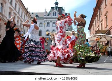 LJUBLJANA, SLOVENIA - AUGUST 31: Society Luna Gitana with presentation of their society on Dvorni square in Ljubljana, Slovenia, on August 31, 2013, with colorful flamenco dancing, music and banquet.