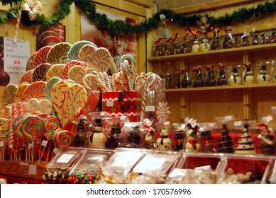 LJUBLJANA, SLOVENIA - DECEMBER 28, 2013: Wooden kiosk with heart shaped candies, lollypops and other treats and gifts for Christmas and New year's on  the street at pedestrian zone in the evening.