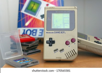 LJUBLJANA, SLOVENIA - DECEMBER 30, 2013: Photo of an original Nintendo handheld video game device Game boy (1989) with Tetris game playing.Showing obvious signs of longtime use.