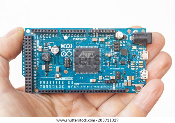 LJUBLJANA, SLOVENIA - FEBRUARY 20, 2015: Photo of Arduino Due micro controller board in the hand. It is the first Arduino board based on a 32-bit ARM core micro-controller.