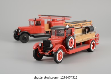 LJUBLJANA, SLOVENIA - JANUAR 17, 2019: Old USSR 1940s fire engine trucks precision scale 1:43 toy models. PMZ-1 vehicle based on ZIS-11 truck in front of PMZ-2 (ZIS-5) machine on background.