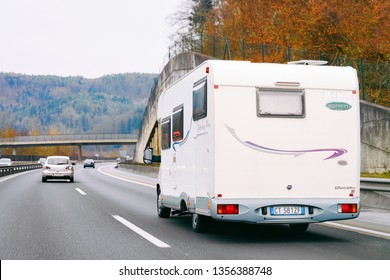 Ljubljana, Slovenia - January 16, 2019: White Camper rv in road. Caravan on highway. Transport with driver. Motorhome vehicle for journey traveling.