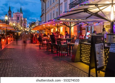 LJUBLJANA, SLOVENIA - JANUARY 5th 2017: Cankarjevo nabrezje street with its outdoors restaurants at dusk after the sunset, Slovenia