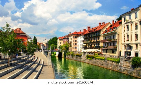 LJUBLJANA, SLOVENIA -  JULY 28, 2014: Old town embankment in Ljubljana. Ljubljana is the business and cultural center of the country.