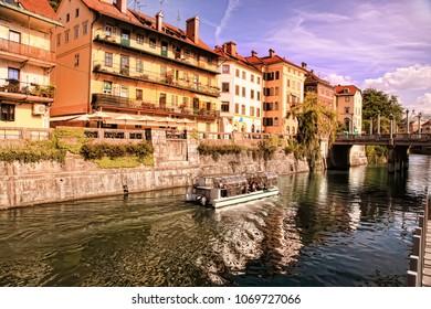 LJUBLJANA, SLOVENIA -  JULY 28, 2017: Old town embankment in Ljubljana. Ljubljana is the business and cultural center of the country.
