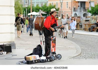 LJUBLJANA, SLOVENIA - JULY 9, 2009: Street musician one-man-band Jimmy Jimmy performing multiple instruments