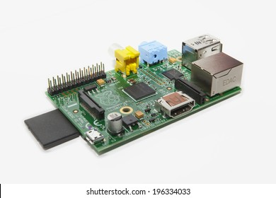 LJUBLJANA, SLOVENIA - JUNE 2, 2014: Photo showing a Raspberry Pi credit card sized single board computer developed in the UK by the Raspberry Pi Foundation. It has SD card attached on the left side.
