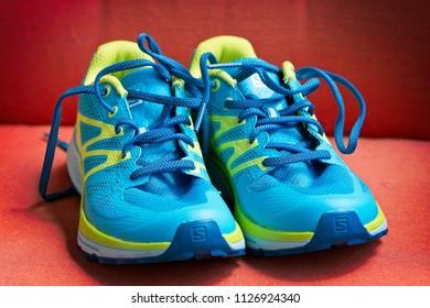 LJUBLJANA, SLOVENIA - JUNE 25, 2018: Illustrative editorial photo of brand new women's Salomon Sense Escape training and racing trail running shoes
