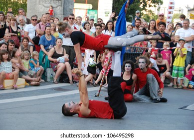 LJUBLJANA, SLOVENIA - JUNE 28: Croatian circus group Kam Hram with performance Look At The Sky at traditional street theater Ana Desetnica on June 29, 2012 in Ljubljana, Slovenia. Acrobatic show.