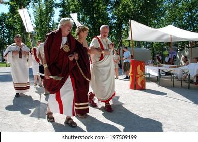 LJUBLJANA, SLOVENIA - JUNE 7, 2014: Roman civilians walk at Roman camp. Celebration of 2000th anniversary of old Roman city Emona (now Ljubljana), event organized by Historical Society Poetovio LXIX.