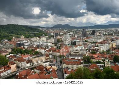 Ljubljana Slovenia with Karawanks Kamnik Savinja limestone Alps and pink Franciscan Church of the Annunciation Preseren Square and Ljubljanica canal