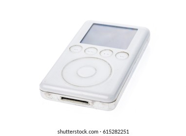 Ljubljana, Slovenia - March 15, 2017:  Old Apple iPod Classic 3rd Generation 15Gb 2003 mp3 player. Vintage used and worn white Apple iPod mp3 player isolated on white background.