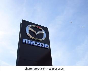 LJUBLJANA, SLOVENIA - MARCH 22 2019: Brand logo at the entrance to Mazda dealership. Mazda is a Japanese multinational car manufacturer.
