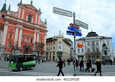 LJUBLJANA, SLOVENIA - MARCH 4, 2016: Electric minibus, called Kavalir, drives people around the pedestrian zone in the center of the city for free. Here on Preseren square.  Environmental friendly.