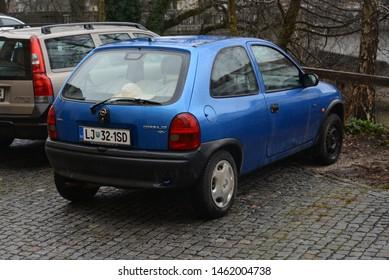 LJUBLJANA, SLOVENIA - MARCH 7, 2016: Opel Corsa B classic German compact three door city 1990s car on the street