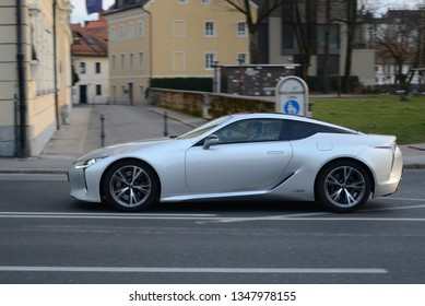 LJUBLJANA, SLOVENIA - MARCH 9, 2019: Lexus LC500h a Hybrid power grand tourer manufactured by the Japanese automaker Lexus, a luxury division of Toyota on fast moving in the city street