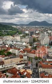 Ljubljana, Slovenia - May 13, 2017: Ljubljana Slovenia with Karawanks, Kamnik Savinja, limestone Alps and Franciscan Church of the Annunciation Preseren Square from Castle Hill