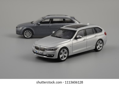 LJUBLJANA, SLOVENIA - MAY 15, 2018: BMW 3-series Touring F31 die-cast scale model in front of modern Skoda Octavia A7 Estate car scale model 1:43 size.