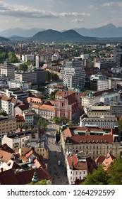 Ljubljana, Slovenia - May 21, 2017: Ljubljana capital city of Slovenia with the Karawanks, Kamnik Savinja limestone Alps and Franciscan Church at Preseren Square from Ljubljana Castle