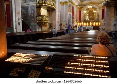 Ljubljana, Slovenia - May 21, 2017: Interior of the St. Nicholas Ljubljana Cathedral Catholic church with votive candles at the back of the church pews Ljubljana Slovenia