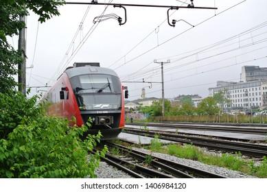 LJUBLJANA, SLOVENIA - MAY 23, 2019: Slovenian Railways train on the railroad (Slovenian: Slovenske Zeleznice, SZ) in the Ljubljana city