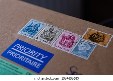 LJUBLJANA, SLOVENIA - NOVEMBER 22, 2019: Swiss Post Priority delivery small packet with Switzerland post stamps. Selected focus.