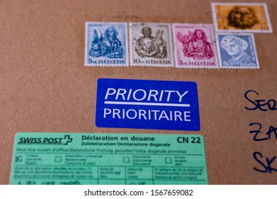 LJUBLJANA, SLOVENIA - NOVEMBER 22, 2019: Swiss Post Priority delivery letter with Switzerland post stamps and filled custom declaration CN 22. Selected focus.
