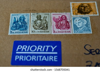 LJUBLJANA, SLOVENIA - NOVEMBER 22, 2019: Swiss Post Priority delivery letter with Switzerland post stamps. Selected focus.