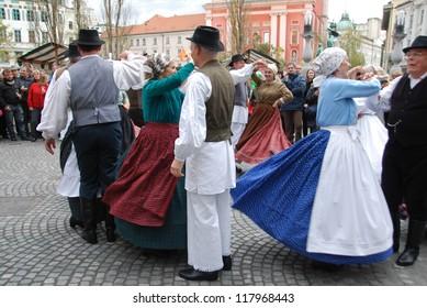 LJUBLJANA, SLOVENIA - NOVEMBER 3: Veterans - dancers of folklore group Tine Rozanc dance on the square at Ljubljana Wine Route for St. Martin holiday in Ljubljana, Slovenia on November 3, 2012.