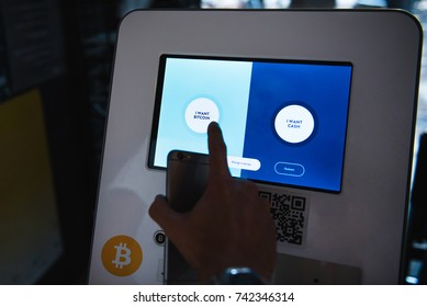 Ljubljana, Slovenia- OCT 18, 2017: Bitcoin automat or machine or bank. Buying and selling bitcoins, one of new era cryptocurrency. Now you can pay with them on Amazon.