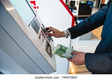 Ljubljana, Slovenia- OCT 18, 2017: Bitcoin machine or bank. Buying and selling bitcoins, one of new era cryptocurrency. Business mans hand.