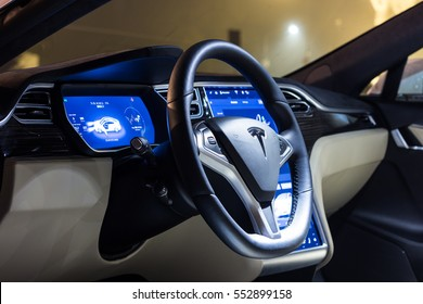 LJUBLJANA, SLOVENIA - October 13, 2016: The interior of a Tesla Model S electric car with steering wheel and dashboard at night