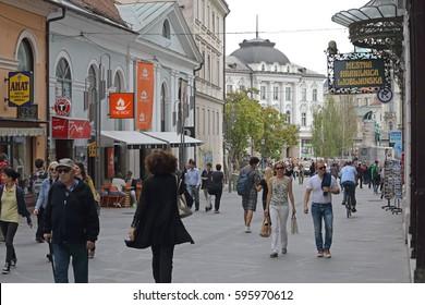 LJUBLJANA, SLOVENIA - OCTOBER 13: Pedestrians at Copova Street in Ljubljana on OCTOBER 13, 2014. People Walking at Pedestrian Zone in Ljubljana, Slovenia.