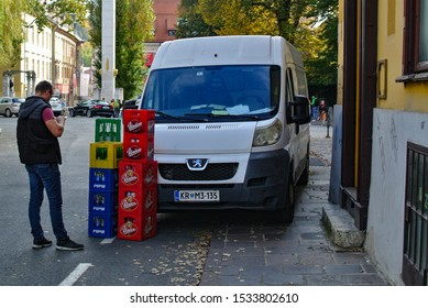 LJUBLJANA, SLOVENIA - OCTOBER 17, 2019: White van man at work with beer Union and Pepsi Cola bottles in boxes