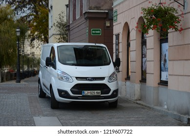 LJUBLJANA, SLOVENIA - OCTOBER 25, 2018: Ford Transit White van at work in the centre of the city