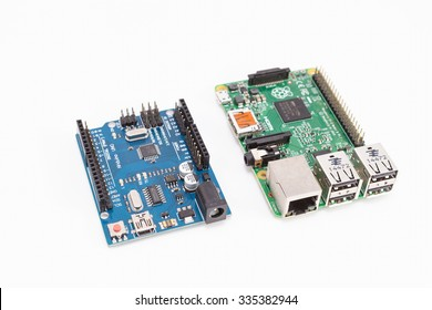 LJUBLJANA, SLOVENIA - OCTOBER 31, 2015: Photo showing very popular Arduino compatible microcontroller and Raspberry Pi credit card sized single board computer. Both use open source software.