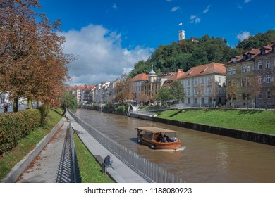 LJUBLJANA, SLOVENIA - SEPTEMBER 24, 2018: Ship on river Ljubljanica in historic center of Ljubljana