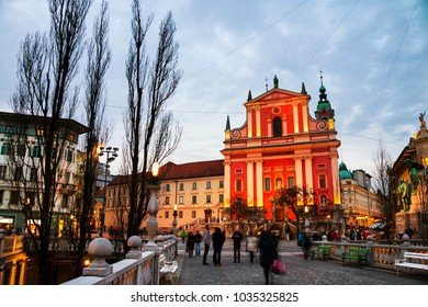 Ljubljana, Slovenia. Triple Bridge with church and famous old buildings in the city center. Sunset in Ljubljana, Slovenia