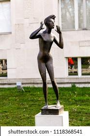 "LJUBLJANA, SLOVENIA-MAR. 29, 2015:  Standing just outside the Museum of Modern Art is the bronze sculpture ""Odmev"" (Echo) by Karel Putrih."